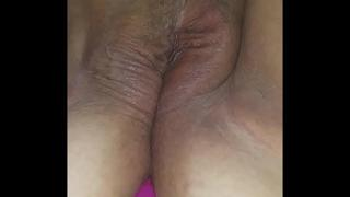 Wet pussy enjoys toy in her ass while she cums